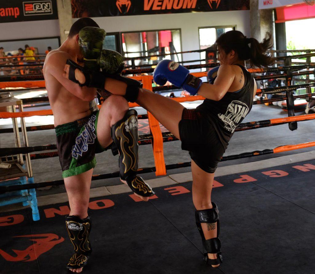 sparring kick shinguards thailand boxing camp man woman muay ying