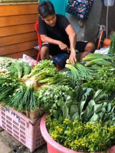 muangthai helping wife sell vegetables in Khlong Suan Phlu Resort