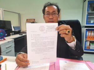 Director Wibun Champaen, from the office of the Boxing Committee, signs order on July 2