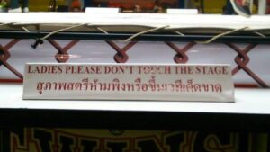 A sign that's been on each side of the Lumpinee ring since tourists starting watching fights at the stadium lumpinee women female dont touch