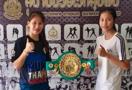 sanaejan and buakaw at weigh ins with wbc muaythai belt. they became the first women to grace the lumpinee boxing stage